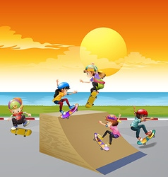 Children playing skateboard on the ramp vector