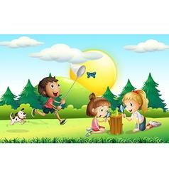 Children catching butterfly in the garden vector image
