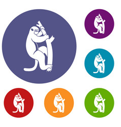 Macaque on a tree icons set vector