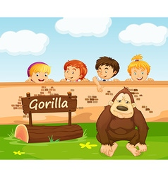 Children looking at gorilla in the zoo vector image