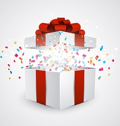 Gift box with confetti vector image vector image