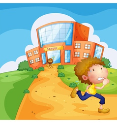 A boy running and a lion near the school vector image