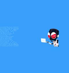 Robot hacker with laptop computer over circuit vector