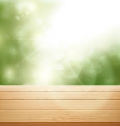 Wooden table on background of trees vector