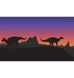 Silhouette of iguanodon in hills vector