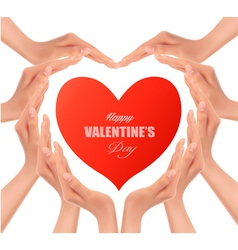 Heart of hands holding a red heart vector image vector image