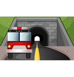 Fire engine driving out of tunnel vector