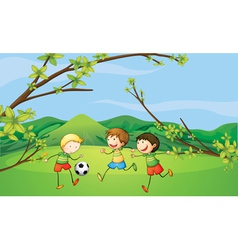 Kids playing football vector image vector image