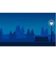 Silhouette of chair with lamp at night on garden vector