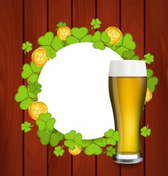 Greeting card with glass of light beer shamrocks vector