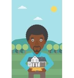 Man holding house model vector