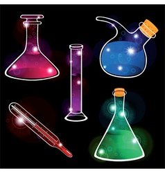 Set of laboratory flasks on black background vector