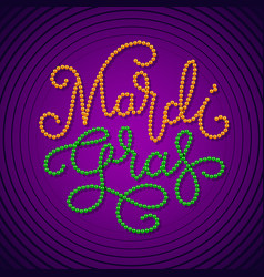 Mardi gras lettering consist of gold green beads vector