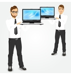 Young successful career man holding laptop vector