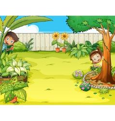 A boy and a girl hiding in the garden vector image
