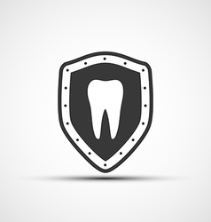 shield with a human tooth vector image vector image