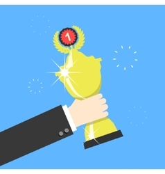 Hand holding winners trophy award vector image vector image