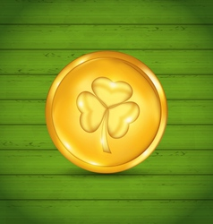 Golden coin with clover on green wooden texture vector
