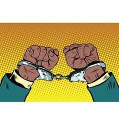 Hands up african american in handcuffs vector