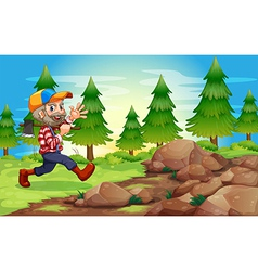 A cheerful lumberjack near the rocks vector image vector image