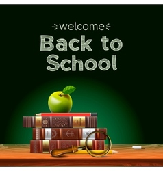 Back to school school books with apple on desk vector image
