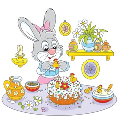 Bunny cooks a holiday cake to Easter vector image