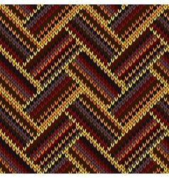 Seamless knitted pattern yellow orange red brown vector