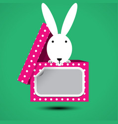 Rabbit sits in box for gift with sticker vector