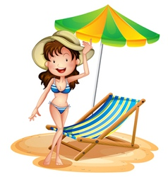 A girl near a foldable beach bed and umbrella vector