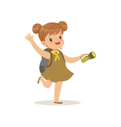 Lovely little girl in scout dress with flashlight vector