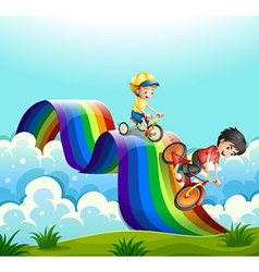 Kids riding bike over the rainbow vector image vector image
