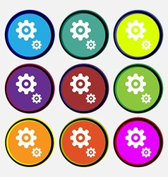 gears icon sign Nine multi colored round buttons vector image