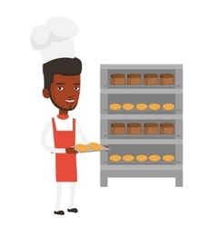 Happy young male baker holding tray of bread vector