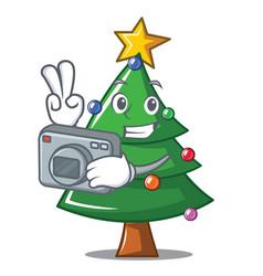 Photographer christmas tree character cartoon vector