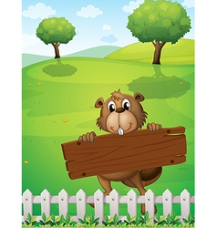A beaver with an empty wooden board vector