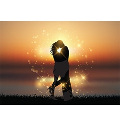 Couple kissing against a sunset background vector