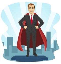 Businessman dressed like superhero vector