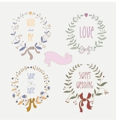 Hand drawn set of wedding wreaths and ribbons vector image