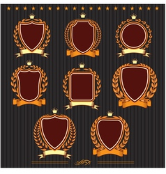 Insignia designs set shields laurel wreaths and ri vector image