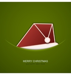 Modern christmas hat on green background vector