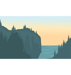 View of river and cliff silhouette vector