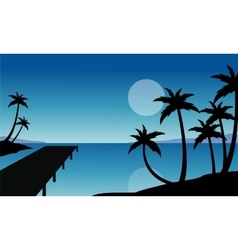 Silhouette of palm and pier scenery vector