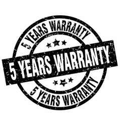 5 years warranty round grunge black stamp vector