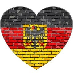 German flag on a brick wall in heart shape vector