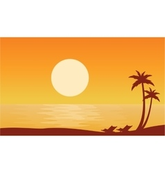 Silhouette of beach on orange backgrounds vector