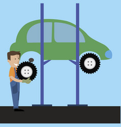 workshop employee change a tire on the car vector image vector image