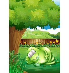 A fat monster sleeping under the tree at the yard vector image