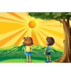Two kids watching the sunset vector image