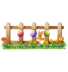 Easter eggs at the fence and a bunny vector