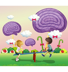 Kids playing at the park with giant candies vector image